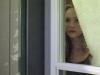 Jennifer alla finestra sul cortile